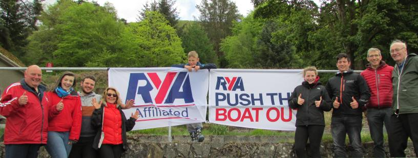 People enjoying themselves at Merthyr Tydfil Sailing Club with banners on display